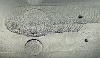 Milling-machine tool marks inside the case lid.