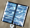 Miniature solar panel recharges batteries in a solar-powered project